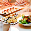 Banquet table with snacks — Stock Photo #5183510