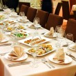 Banquet table with snacks — Stock Photo #5183741