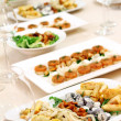 Banquet table with snacks — Stock Photo