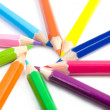 Coloured pencils arranged in the form of the sun — Stock Photo