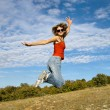 Beautiful girl in jump — Stock Photo