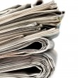 A stack of newspapers. - Stock Photo