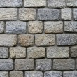 A wall built of stones. - Stock Photo