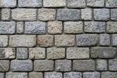 Un mur construit de pierres. — Photo