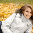 Girl lying in autumn park — Stock Photo