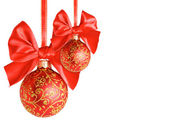 Red Christmas balls with bows — Stock Photo