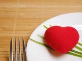 Red heart served on the plate — Stock Photo