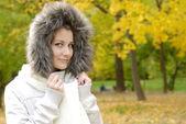 Teenager girl in autumn park — Stock Photo