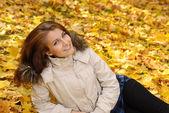 Girl lying in autumn park — Stock Photo