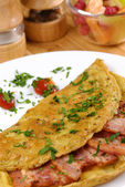 Omelet with bacon — Stock Photo