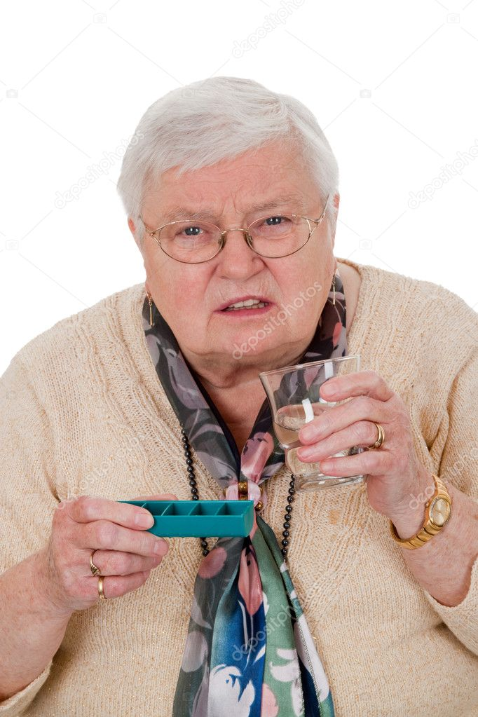 Elderly woman with pills and glass of water - isolated — Stock Photo #3962246