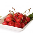 Red cherries on a plate — Stock Photo