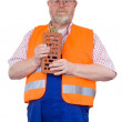 Construction worker with model house — Stock Photo #4150945