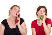 Girlfriends on the phone — Stock Photo