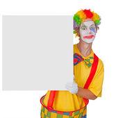 Clown with billboard — Stock Photo