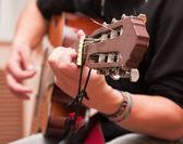 Man playing an accoustic guitar — Stock Photo