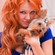 Red-haired woman and little dog - Stock Photo