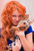 Red-haired woman and little dog — Stock Photo
