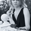 Beautiful woman drinking champagne in black and white with soft — Stock Photo