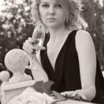 Beautiful woman drinking champagne from wineglass — Stock Photo #4666035