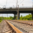 Railway tracks and bridge - Stock Photo