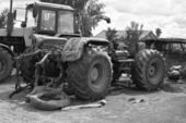 Old tractors in black and white tones — Stock Photo