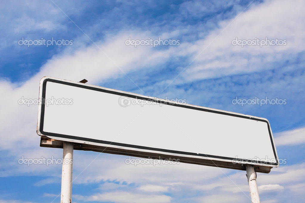 Empty road sign against a background of blue sky with clouds — Stock Photo #5020969