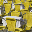 Sidewalk cafe chairs and tables — Stock Photo