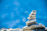 Stones stack over blue sea — Stock Photo