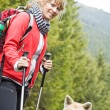 Nordic Walking with dog — Stock Photo