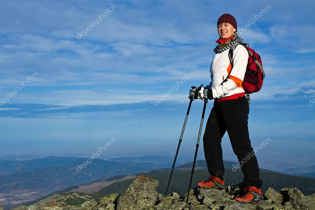 Nordic Walking in Autumn mountains — Stock Photo #4207154
