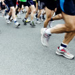 Marathon runners on city street — Stock Photo #4527759