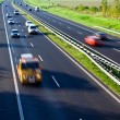 Stock Photo: On the road, motion blur, traffic and cars