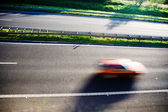 Red car, motion blur — Stock Photo