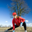 Woman stretches after cross country running — Stock Photo #5175551