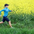 Woman running outdoors on spring — Stock Photo