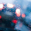 Постер, плакат: Driving in a rain and traffic jam