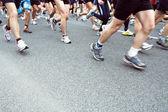 Running in city marathon on street, motion blur — Stock Photo