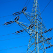 Silhouette of electrical pylon over blue sky — Stock Photo