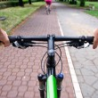 Commuting on bicycle path - Stock Photo