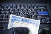 Identity theft on laptop computer — Stock Photo