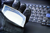 Identity theft on laptop computer — Stock Photo