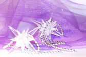Holiday stars on violet background — Stock Photo