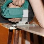 Jigsaw, electric saw cutting plank — Stock Photo #4412526