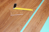 Ruler and laminate on substrate — Stock Photo
