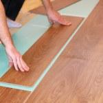 Worker installing new laminate flooring — Stock Photo