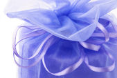 Violet gift with ribbon`s bow — Stock Photo