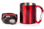 Old travel cup with carabine-handle and tourist flashlight on wh — Stock Photo