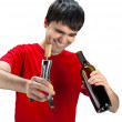Stock Photo: Smiling mwith uncorked bottle of wine