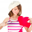 Cute girl cutting valentine heart — Stok fotoğraf